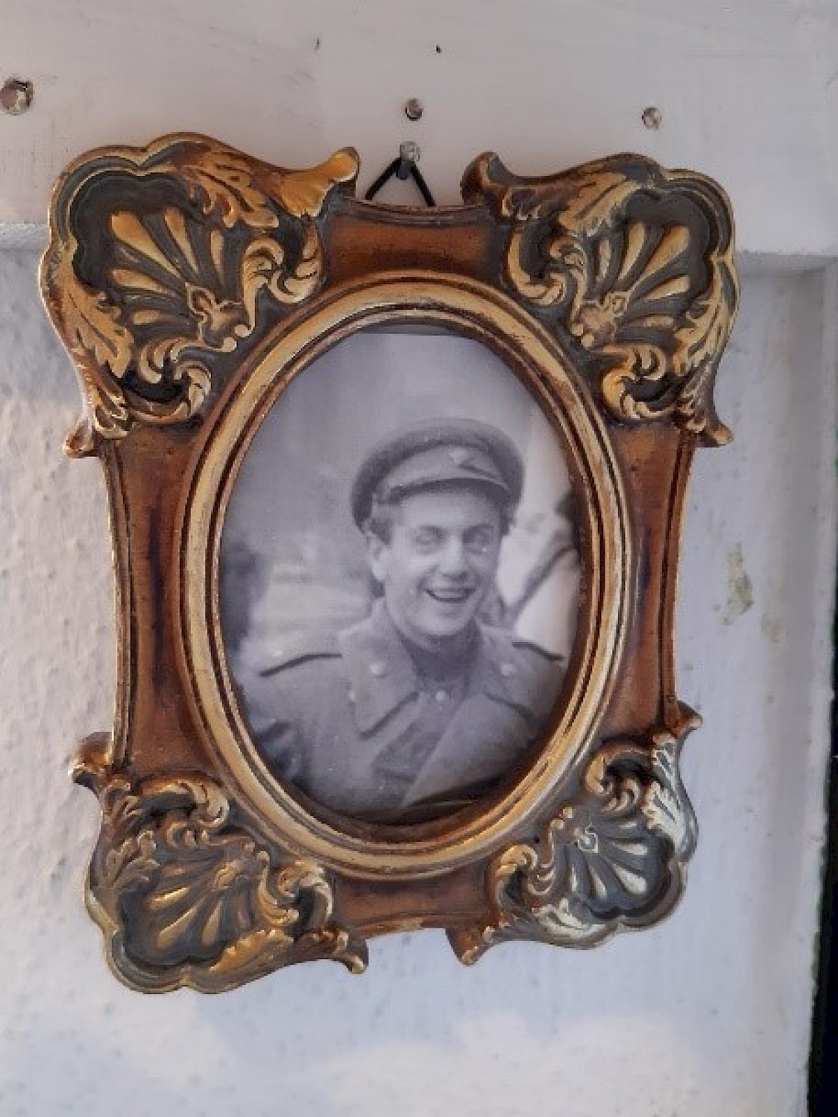 Framed picture of a soldier in uniform.